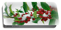 Portable Battery Charger featuring the photograph Holly Berries On White by Sharon Talson