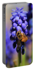 Honeybee In A Sea Of Blue Portable Battery Charger by Chris Berry