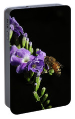 Portable Battery Charger featuring the photograph Honeybee On Golden Dewdrop by Richard Rizzo