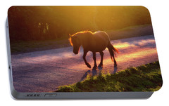 Horse Crossing The Road At Sunset Portable Battery Charger by Mikel Martinez de Osaba