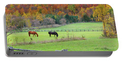 Horses Contentedly Grazing In Fall Pasture Portable Battery Charger