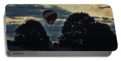 Hot Air Balloon Between The Trees At Dusk Portable Battery Charger