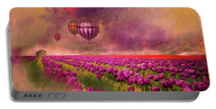 Portable Battery Charger featuring the photograph Hot Air Balloons Over Tulip Fields by Jeff Burgess