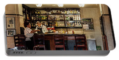 Portable Battery Charger featuring the photograph Hotel Presidente Bar Havana Cuba by Charles Harden