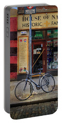 Portable Battery Charger featuring the photograph House Of Names Bicycle by Craig J Satterlee