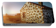 Portable Battery Charger featuring the photograph House On The Cliff by Carlos Caetano