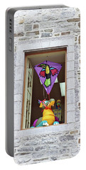 Portable Battery Charger featuring the photograph How Much Is That Dragon In The Window by John Schneider