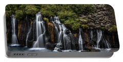 Portable Battery Charger featuring the photograph Hraunfossar In The Gloom by Rikk Flohr