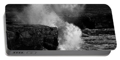 Huge Wave Breaking On The Rocks Portable Battery Charger