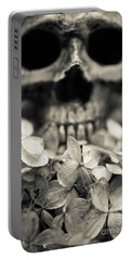 Portable Battery Charger featuring the photograph Human Skull Among Flowers by Edward Fielding