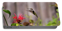 Humming Bird Hovering Portable Battery Charger by David Stasiak