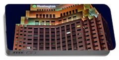 Portable Battery Charger featuring the photograph Huntington Bank Cleveland by Frozen in Time Fine Art Photography