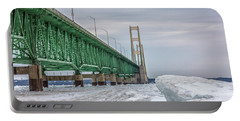 Portable Battery Charger featuring the photograph Ice And Mackinac Bridge  by John McGraw