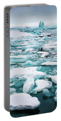 Portable Battery Charger featuring the photograph Ice Galore In The Jokulsarlon Glacier Lagoon Iceland by Matthias Hauser