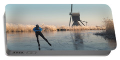 Ice Skating Past Frosted Reeds And A Windmill Portable Battery Charger