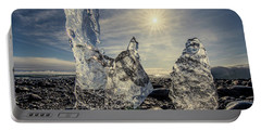 Portable Battery Charger featuring the photograph Iceberg Fingers Catching The Sun by Rikk Flohr