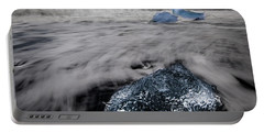 Portable Battery Charger featuring the photograph Iceberg Remnant by Rikk Flohr