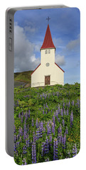 Portable Battery Charger featuring the photograph Icelandic Church Among The Fields Of Lupine by Edward Fielding