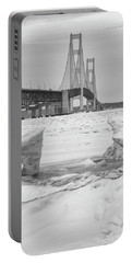 Portable Battery Charger featuring the photograph Icy Black And White Mackinac Bridge  by John McGraw