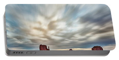 Portable Battery Charger featuring the photograph In The Clouds by Jon Glaser