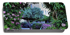 In The Garden At Mount Zion Hotel  Portable Battery Charger by Lydia Holly