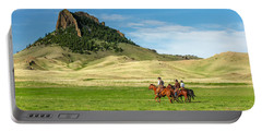 Portable Battery Charger featuring the photograph In The Shadow Of Birdtail Butte by Todd Klassy