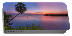 Indian River State Park Bursting Sunset Portable Battery Charger by Justin Kelefas
