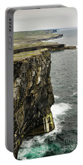 Portable Battery Charger featuring the photograph Inishmore Cliffs And Karst Landscape From Dun Aengus by RicardMN Photography