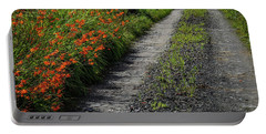 Portable Battery Charger featuring the photograph Irish Country Road Lined With Wildflowers by James Truett