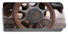 Portable Battery Charger featuring the photograph Iron Train Wheel by Aidan Moran