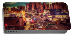Portable Battery Charger featuring the photograph It Takes A Village - New York Street Scene by Miriam Danar