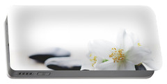 Jasmine Flower On Spa Stones Portable Battery Charger