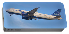 Portable Battery Charger featuring the photograph Jet Blue by Dart Humeston