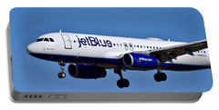 jetBlue Airlines plane in flight Portable Battery Charger