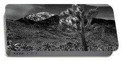 Portable Battery Charger featuring the photograph Joshua Tree In Black And White In Joshua Park National Park With The Little San Bernardino Mountains by Randall Nyhof