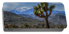 Portable Battery Charger featuring the photograph Joshua Tree In Joshua Park National Park With The Little San Bernardino Mountains In The Background by Randall Nyhof