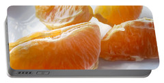 Juicy Orange Slices On A Blue Glass Plate Portable Battery Charger