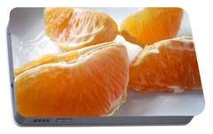 Portable Battery Charger featuring the photograph Juicy Orange Slices On A Blue Glass Plate by Louise Kumpf