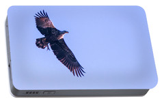 Portable Battery Charger featuring the photograph Juvie Bald Eagle With Fish In Flight by Jeff at JSJ Photography