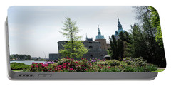 Portable Battery Charger featuring the photograph Kalmar Medieval Castle By Summer by Kennerth and Birgitta Kullman