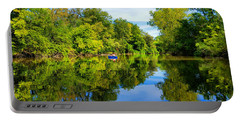 Portable Battery Charger featuring the photograph River Kayaking by Michael Rucker