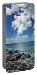 Portable Battery Charger featuring the photograph Key West Clouds On The Rocks by Bob Slitzan