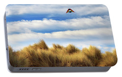Portable Battery Charger featuring the photograph Kite Over The Hill by James Eddy
