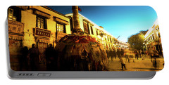 Portable Battery Charger featuring the photograph Kora At Night At Jokhang Temple Lhasa Tibet Artmif.lv by Raimond Klavins