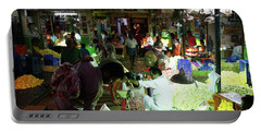 Portable Battery Charger featuring the photograph Koyambedu Flower Market Stalls by Mike Reid