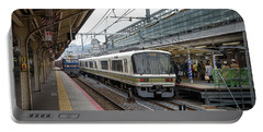 Portable Battery Charger featuring the photograph Kyoto To Osaka Train Station, Japan by Perry Rodriguez