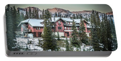 Portable Battery Charger featuring the photograph Lake Louise Lodge by Bill Howard