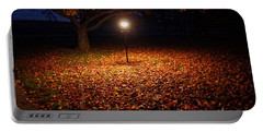 Portable Battery Charger featuring the photograph Lamp-lit Leaves by Lars Lentz