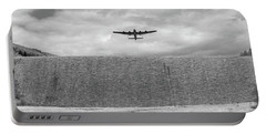 Portable Battery Charger featuring the photograph Lancaster Over The Derwent Dam Bw Version by Gary Eason
