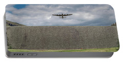 Portable Battery Charger featuring the photograph Lancaster Over The Derwent Dam by Gary Eason
